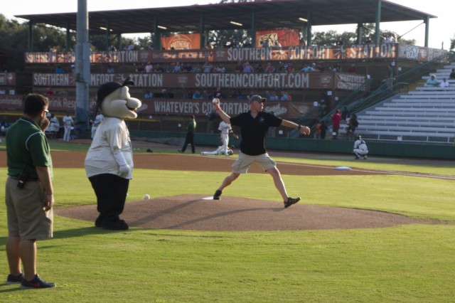 """Command Sgt. Maj. George """"Mike"""" Dove, then the command sergeant major of 3rd Combat Aviation Brigade, 3rd Infantry Division, throws out the first pitch at Military Appreciation Night honoring Savannah's military community Aug. 13, 2015, at historic Grayson Stadium. (Photo by Capt. Danielle Killian, 3rd CAB Public Affairs)"""