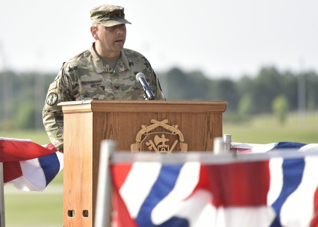 Col. Kirk Whittenberger addresses the audience after taking command of the 14th Military Police Brigade during a ceremony July 14 on Gammon Field.