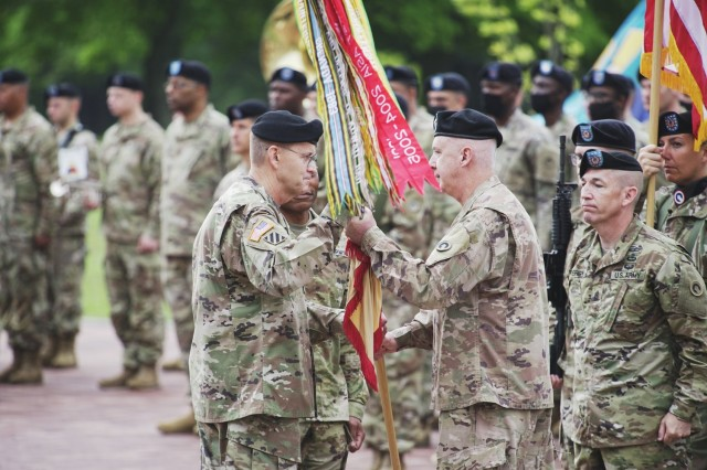 Maj. Gen. John P. Sullivan, outgoing commanding general, 1st Theater Sustainment Command, passes the colors to Lt. Gen. Terry R. Ferrell, commanding general, U.S. Army Central, during a change of command ceremony held July 13, 2021 outside Fowler Hall at Fort Knox, Kentucky. (U.S. Army photo by Sgt. Owen Thez, 1st TSC Public Affairs)