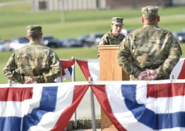 Brig. Gen. Niave Knell, U.S. Army Military Police School commandant, speaks to Cols. Robert Arnold (left) and Kirk Whittenberger (right) - outgoing and incoming 14th Military Police Brigade commander, respectively - during a change-of-command ceremony July 14 on Gammon Field.
