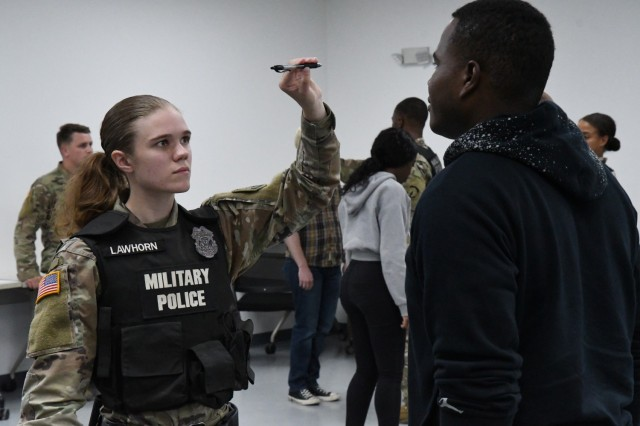 Soldiers from the 91st Military Police Battalion practice field sobriety testing during Mountain Guardian Academy training at Fort Drum. The academy is a blend of classroom lectures and hands-on practical exercises that tests Soldiers in a variety of law enforcement situations. (Photo by Mike Strasser, Fort Drum Garrison Public Affairs)