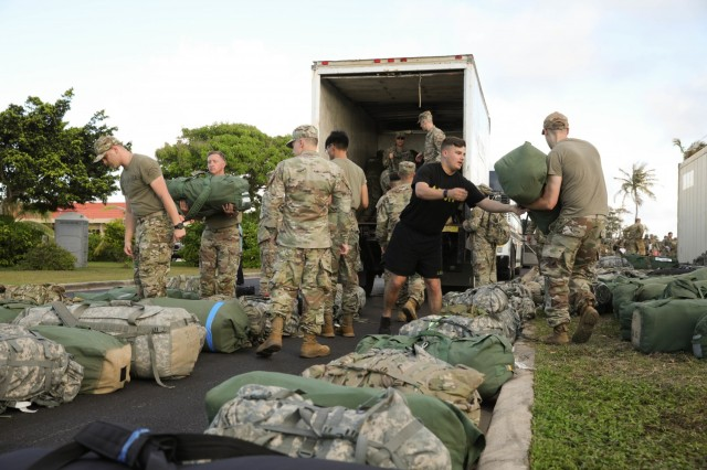 America's First Corps Soldiers offload equipment for exercise Forager 21 at Anderson Air Force Base, Guam, July 10, 2021. Forager 21 bolsters the U.S. Army's capability to rapidly deploy personnel and equipment in order to project power across a complex operational environment in the Pacific region. (U.S. Army photo by Sgt. David Resnick)
