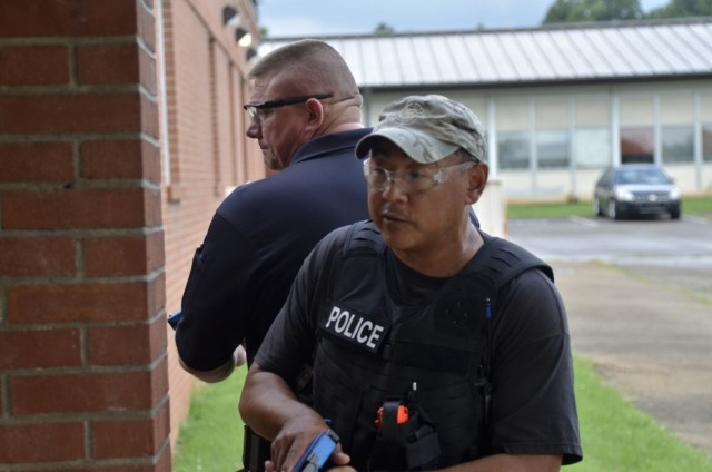 Training officer Erett Oden, Clarksville Police Department, foreground, teams up with Cpl. Robert Reynolds, Montgomery County Sheriff's Office, to safely enter a building and respond to a simulated threat during Active Attack Integrated Response training, hosted July 12-16 at Jackson Elementary School.