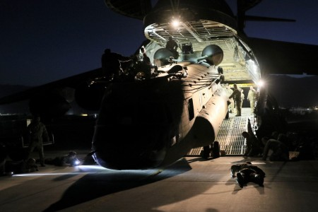Aerial porters work with maintainers to load a CH-47 Chinook into a C-17 Globemaster III in support of the Resolute Support retrograde mission in Afghanistan, June 16, 2021.