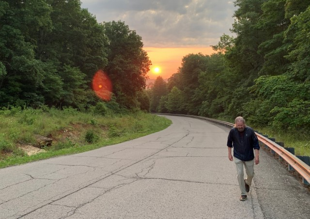 The sun rises over Misery Hill as Goatley makes his third trek toward the summit.