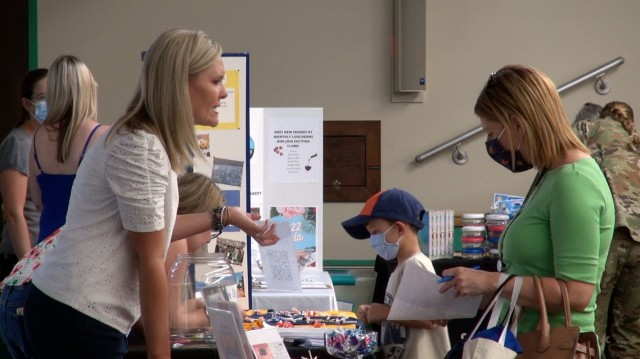 """Educators and supporting partner agencies offer information and advice to members of the Fort Huachuca, Ariz. community during a """"Back to School"""" fair."""