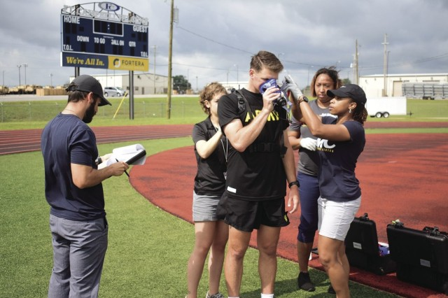 Fort Campbell Army Wellness Center staff strap the K5 portable VO2 unit onto 1st Lt. Brian Dudeck July 13 before he begins running on the track at Fryar Stadium. Dudeck is an Iron Rakkasan assigned to 3rd Battalion, 187th Infantry Regiment, 101st Airborne Division (Air Assault).