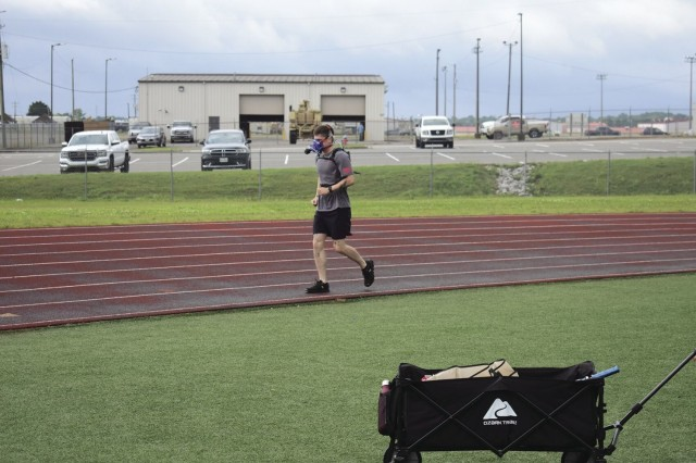 Sergeant Garret Turner, Headquarters and Headquarters Company, 2nd Battalion, 502nd Infantry Regiment, 2nd Brigade Combat Team, 101st Airborne Division (Air Assault), wears the K5 portable VO2 unit July 13 while running the track at Fryar Stadium.