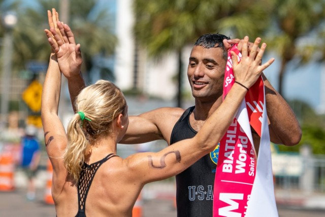Sgt. Amro Elgeziry, right, is congratulated by Sgt. Samantha Schultz during the 2019 Biathle/Triathle World Championships in St. Petersburg, Florida. Both Elgeziry and Schultz will compete in the modern pentathlon at the Olympic Games in Tokyo.