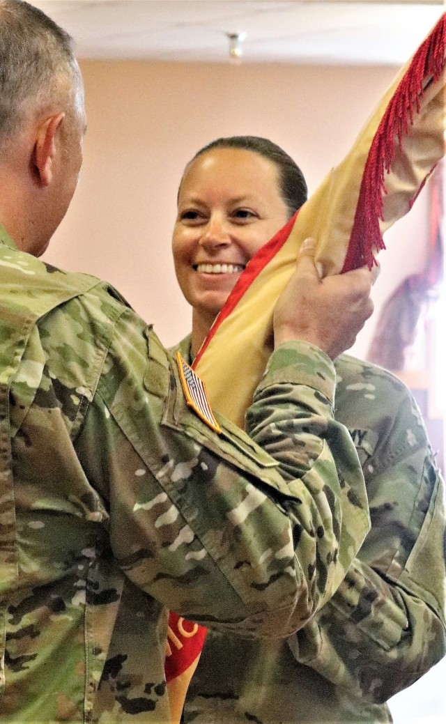Command Sgt. Maj. Raquel DiDomenico, new Fort McCoy Garrison command sergeant major, receives the garrison flag July 1, 2021, from Garrison Commander Col. Michael Poss during a change of responsibility ceremony at Fort McCoy, Wis. DiDomenico replaced Command Sgt. Maj. Paul Mantha as the garrison command sergeant major during the ceremony. She has previously served at Fort McCoy at the Fort McCoy Noncommissioned Officer Academy. A command sergeant major (CSM) is the most senior enlisted member of a color-bearing Army unit. The CSM is appointed to serve as a spokesman to address the issues of all Soldiers, from enlisted to officers, from warrant officers and lieutenants to the Army's highest positions. As such, they are the senior enlisted advisor to the commander. The exact duties vary depending on the unit commander, including observing training and talking with Soldiers and their families. (U.S. Army Photo by Scott T. Sturkol, Public Affairs Office, Fort McCoy, Wis.)