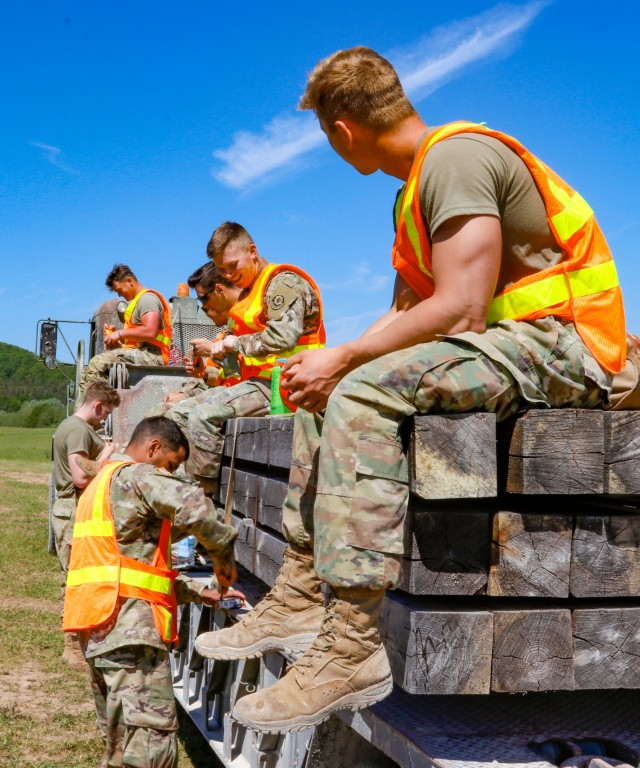 Engineers with third platoon, Argonaut Troop, Regimental Engineer Squadron, 2nd Cavalry Regiment take a break from working on a 100-meter trench on Hohenfels Training Area, Hohenfels, Germany, to eat lunch June 3, 2021. The trench will be utilized for a number of training events throughout the year, beginning with the European Best Sniper Competition Aug. 5-14 on HTA. (U.S. Army photo by Master Sgt. Ryan C. Matson)