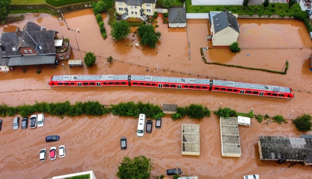 A German train is literally stopped on its tracks by rising floodwater in the German village of Kordel July 15. (Photo by Sebastian Schmitt)