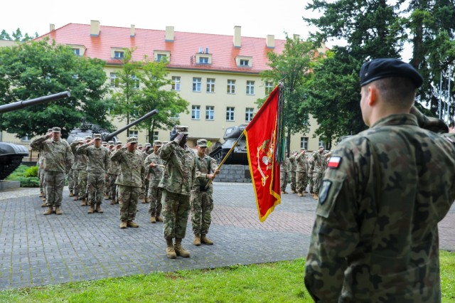The 53rd Movement Control Battalion Command Sgt. Maj. LaVaughn Brown stands before his Soldiers as they salute during the transfer of authority ceremony in Żagań, Poland, July 14, 2021. The 53rd finished up a nine-month rotation to Poland in support of Atlantic Resolve. Through bilateral, joint and multinational training, Atlantic Resolve builds readiness, increases interoperability and enhances the bond between ally and partner militaries. (U.S. Army photo by Staff Sgt. Jennifer Reynolds/released)
