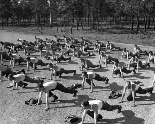 """Group calisthenics for patients in the Camp McCoy, Wis., Station Hospital """"reconditioning program"""" are shown  Aug. 15, 1955. (U.S. Army photo)"""