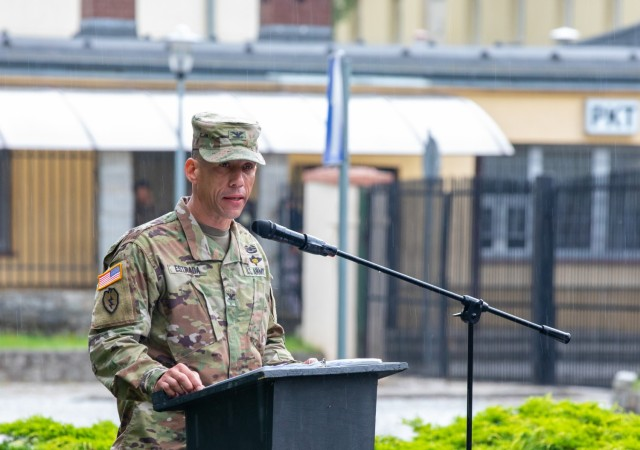 """Commander of the 16th Sustainment Brigade Col. Angel Estrada, speaks briefly at the transfer of authority ceremony between the 53rd Movement Control Battalion and the 49th Transportation Battalion held in Żagań, Poland, July 14, 2021. """"They have done a stellar job; the 53rd has completed over 353 cross-border missions,"""" Estrada said. The 53rd provided movement control operations in support of Atlantic Resolve, a continued set of U.S. rotational deployments that supports NATO. They have executed customs clearance, bus requests, rail, line haul, and port operations throughout their deployment. Atlantic Resolve is funded by the European Deterrence Initiative, which enables the U.S. to enhance deterrence, increase readiness and support NATO. Several other rotations are also funded with EDI, including air defense, logistics and sustainment units. (U.S. Army photo by Pfc. Michael Baumberger)"""