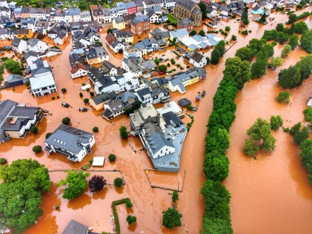The tiny German village of Kordel, poplulation 2,900, is swamped by rising flood waters July 15. (Photo by Sebastian Schmitt)