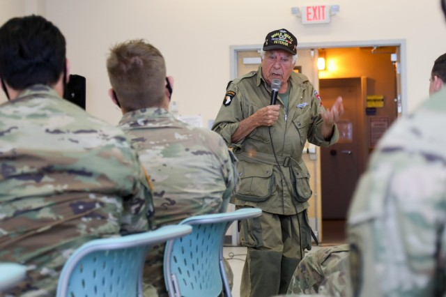 """Vincent Speranza, World War II Veteran and machine gunner from the 501st Infantry Regiment, describes the extreme conditions he and his fellow paratroopers faced during the Battle of the Bulge to junior paratroopers of the 1st Battalion, 501st Infantry Regiment, during a visit to Joint Base Elmendorf-Richardson, July 15, 2021. Speranza traveled to JBER to meet and share stories about his World War II experiences with the paratroopers of the 1-501st PIR and the 4th Infantry Brigade Combat Team (Airborne), 25th Infantry Division, """"Spartan Brigade."""" The Spartan Brigade is the only airborne infantry brigade combat team in the Arctic and Pacific theaters, providing the combatant commander with the unique capability to project an expeditionary force by air."""