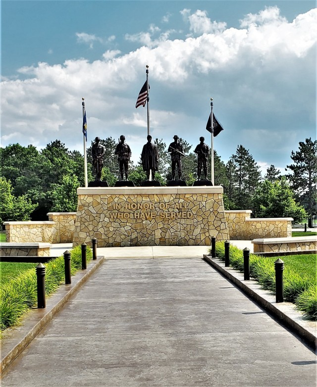 Veterans Memorial Plaza is shown July 1, 2021, at the Commemorative Area at Fort McCoy, Wis. The 900 block of Fort McCoy and the 11-acre area surrounding it are at the hub of the fort's history-preservation efforts and is called the Commemorative Area. The Commemorative Area consists of five World War II-era buildings set aside to help tell Fort McCoy's unique story. These facilities are representative of the types found in the cantonment area when it was constructed in 1942. Three of the buildings — an administrative facility, a dining facility, and a barracks — are set up to depict Soldier life during the 1940s. Display items include a World War II chapel, bunk beds, footlockers, mannequins, and potbelly stoves. Another building highlights four different modern military training venues, and a separate facility shows various training aids. The area also has the Equipment Park. Veterans Memorial Plaza is a tribute to all of the men and women who have served the nation during each era of Fort McCoy's history. (U.S. Army Photo by Scott T. Sturkol, Public Affairs Office, Fort McCoy, Wis.)