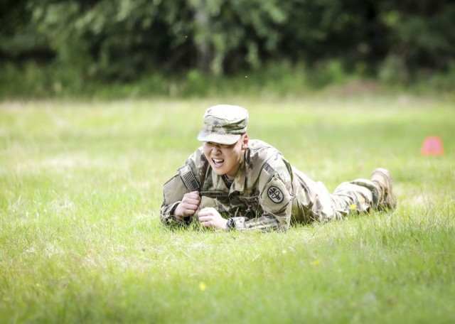 LANDSTUHL, Germany - U.S. Army Spc. Seongjong Jeong, healthcare specialist, U.S. Army Health Clinic Vicenza, performs a low crawl during the medical evacuation event of Landstuhl Regional Medical Center's Best Warrior Competition, July 7. The competition challenged Soldiers from across Germany, Belgium and Italy, physically, emotionally and spiritually as they were tested on various tasks and skills including Army Warrior Tasks, medical knowledge and prolonged field care, stress shoot, military Drill and ceremony, ruck marches, Land navigation, combat lifesaving under pressure, combat water survival, and written and oral examinations.