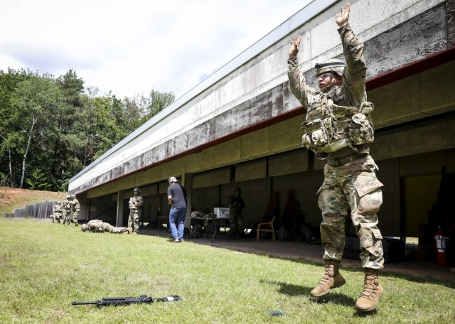 LANDSTUHL, Germany – U.S. Army Spc. Phillip Xu, pharmacy technician, Landstuhl Regional Medical Center, performs a burpee with full combat gear during the stress shoot portion of Landstuhl Regional Medical Center's Best Warrior Competition, July 7. The competition challenged Soldiers from across Germany, Belgium and Italy, physically, emotionally and spiritually as they were tested on various tasks and skills including Army Warrior Tasks, medical knowledge and prolonged field care, stress shoot, military Drill and ceremony, ruck marches, Land navigation, combat lifesaving under pressure, combat water survival, and written and oral examinations.