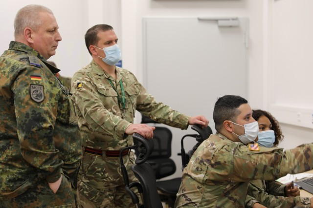 (l to r) German Army Capt. Andreas Kirk, UK WO1 Craig Lovitt, U.S. Army Staff Sgt. John Carmona and U.S. Army Spc. Shakwanna Jeffers monitor Logistic Functional Area Services activity at the Readiness and Movement Coordination Center, Panzer Kaserne, Germany, during DEFENDER-Europe 21. LOGFAS was the mother-tongue for Capable Deployer 2021. The logistic interoperability exercise was linked to Saber Guardian 2021, part of DEFENDER-Europe 21.