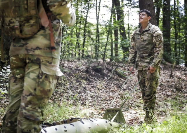 LANDSTUHL, Germany - U.S. Army Spc. Jesse Arellano, patient administration specialist, U.S. Army Health Clinic Baumholder, pauses during a litter drag with a simulated casualty during the medical evacuation event of Landstuhl Regional Medical Center's Best Warrior Competition, July 7. The competition challenged Soldiers from across Germany, Belgium and Italy, physically, emotionally and spiritually as they were tested on various tasks and skills including Army Warrior Tasks, medical knowledge and prolonged field care, stress shoot, military Drill and ceremony, ruck marches, Land navigation, combat lifesaving under pressure, combat water survival, and written and oral examinations.