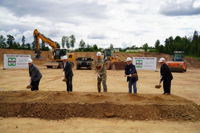 Leaders break ground for a new vehicle maintenance shop at the construction site near Tower Barracks Gate 6, July 15, 2021. From left to right stand 7th Army Training Command Deputy Chief of Staff Dr. Michael Schaefer, Mickan Construction Co. CEO Guenther Hofbeck, U.S. Army Garrison Bavaria Commander Col. Christopher Danbeck, State Construction Office Amberg-Sulzbach Chief Roman Beer, and U.S. Army Corps of Engineers Europe District Regional Program Manager Peter Barth. (Photo by Andreas Kreuzer / USAG Bavaria Public Affairs)