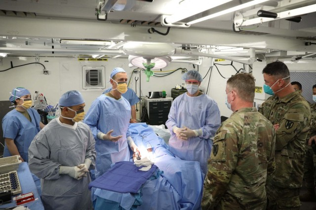 From May 30 through June 4, 2021, the 30th Medical Brigade led multi-national troop response to a simulated battle scenario, including a mass casualty event, as a NATO medical evaluation team observed.  Hanging in the balance was a NATO Role 2 Enhanced certification, validating the 512th FH as capable of providing advanced medical support in the field and meeting NATO's medical doctrine of interoperability. Maj. Gen. Chris Mohan, 21st TSC CG and 21st TSC CSM Sean Howard visit the 512th FH operation room.