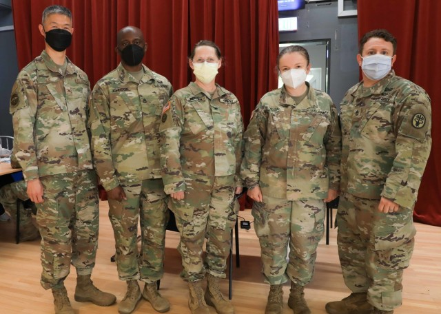 (From left) U.S. Air Force Col. Peter Kim, Chief Medical Officer, Landstuhl Regional Medical Center, U.S. Army Sgt. 1st Class Eldon Johnson, noncommissioned officer in charge, 452nd Combat Support Hospital (CSH), 330th Medical Brigade, 807th Medical Command, U.S. Army Reserve, U.S. Army Col. Ines Berger, commander, 452nd CSH, U.S. Maj. Marielos Vega, chief, Quality and Safety, LRMC, and Sgt. 1st Class Jeffrey Hicks, noncommissioned officer in charge, Department of Public Health, LRMC, stand at the LRMC COVID-19 vaccination site, where the 452nd CSH worked with LRMC to administer thousands of vaccinations over the month of May. (U.S. Army photo by Marcy Sanchez)