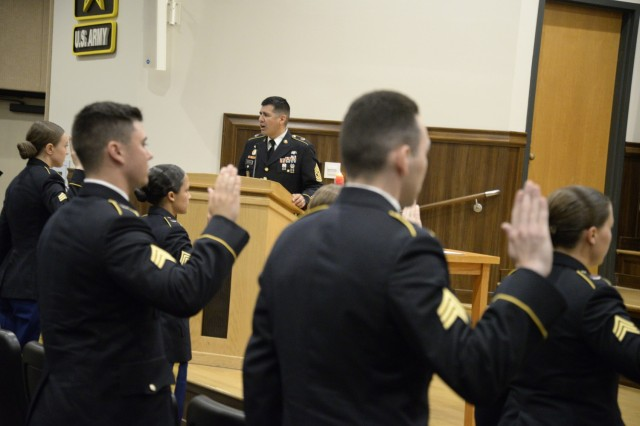 Command Sgt. Maj. John Castillo, General Leonard Wood Army Community Hospital command sergeant major, recites the charge of the noncommissioned officer with 11 newly promoted NCOs at an induction ceremony July 16.