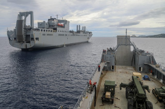 The U.S. Army Vessel Lt. General William B. Bunker (LSV-4), 8th Theater Sustainment Command, conducts a joint maritime equipment transfer of Army Preposition Stock with the U.S. Naval Ship Fisher in Tinian July 16th in support of Defender Pacific 2021. Army Watercraft Systems provide unique capabilities to the Theater Army, allowing rapid and flexible movement of personnel, supplies and equipment in the sea domain.