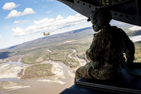 A Soldier looks out from the back of an Army CH-47 Chinook during Northern Edge over Alaska, May 10, 2021. The exercise is designed to improve joint combat readiness.