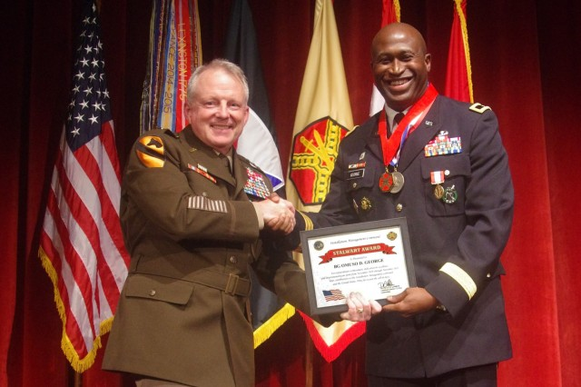 Lt. Gen. Douglas Gabram, Commanding General of U.S. Army Installation Management Command (left), congratulates Brig. Gen. Omuso George for 30 years of service in the U.S. Army at his retirement ceremony July 16 in the Fort Sam Houston Theater.