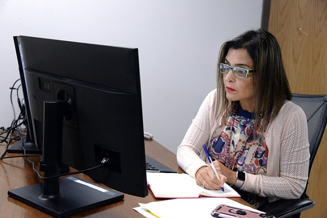 Monica Tillis, program analyst, tracks data from housing assignments while working in the Summer Surge Cell July 21 in Garrison Headquarters. Photo by Prudence Siebert/Fort Leavenworth Lamp