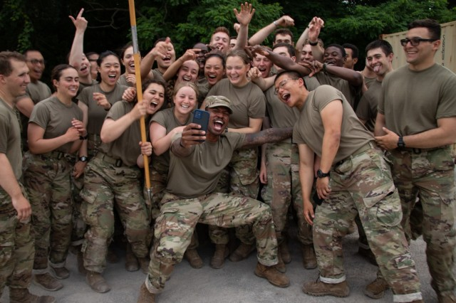 1st Regiment, Alpha Company Cadets pose for a selfie and celebrate after completing the 12 Mile Foot March, the last training event of Advanced Camp in Fort Knox, Ky. June 25, 2021 | Photo by Rachael Kocour, CST Public Affairs Office.