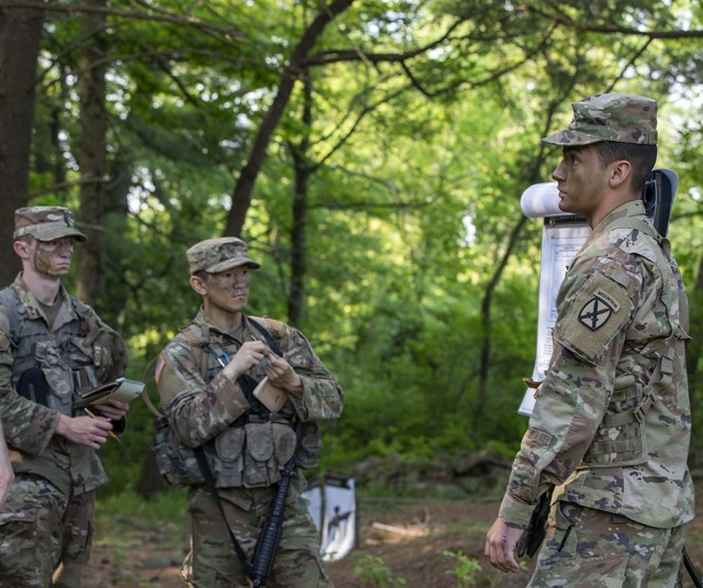 Cadets from Cadet Field Training 8th Company at the U.S. Military Academy practice their warrior tasks and battle drills during Cadet Summer Training at West Point May 26. Cadets practiced utilizing camouflage, as well as a variety of weapon systems. The 2nd Brigade Combat Team, 10th Mountain Division Task Force Soldiers helped the CFT cadet cadre during the training.  (U.S. Army photo by Sgt. Gregory Muenchow)