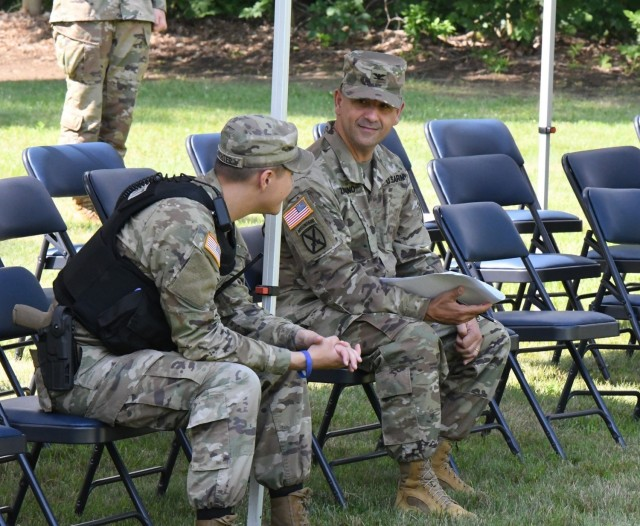 Col. James J. Zacchino Jr. talks with a Soldier from the 91st Military Police Battalion on July 22 during the rehearsal for the Fort Drum garrison change of command ceremony. Zacchino will assume command of the Fort Drum garrison during a ceremony at LeRay Mansion on July 23. (Photo by Mike Strasser, Fort Drum Garrison Public Affairs)
