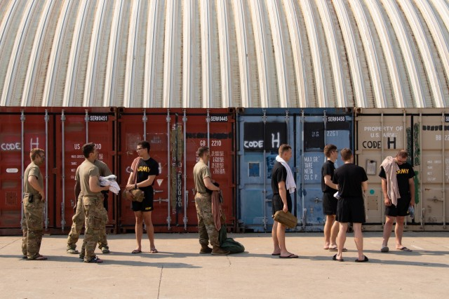 Cadets wait in line to shower during Refit. Cadets receive refit days every three to four days while completing their Field Training Exercise (FTX) during Cadet Summer Training. Fort Knox, Ky., July 5, 2021.   Photo by Olivia Van Den Heuvel, CST Public Affairs