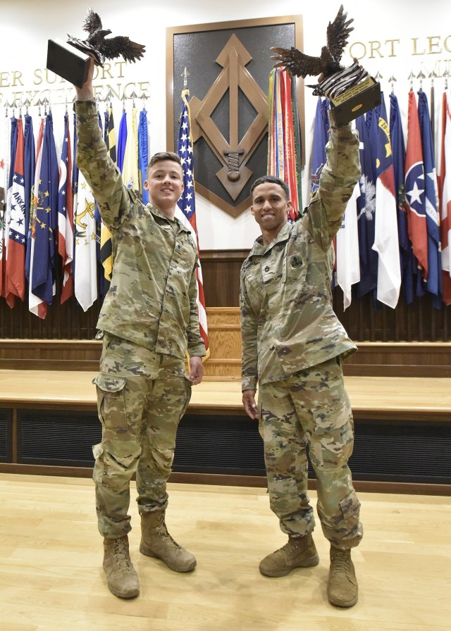 Fort Leonard Wood played host to the U.S. Army Training and Doctrine Command Best Warrior Competition this week. Sgt. 1st Class Joshua Newbury (right), a Sapper Leader Course instructor at Fort Leonard Wood, won in the NCO category, and Spc. Kaelan Pugh, a health care specialist with the 5th Ranger Training Battalion, Fort Benning, Georgia, won in the junior enlisted category. Newbury and Pugh were presented their trophies and the Meritorious Service Medal July 23 at Lincoln Hall Auditorium by Combined Arms Center Command Sgt. Maj. Steve Helton on behalf of Gen. Paul Funk, TRADOC commanding general, and TRADOC Command Sgt. Maj. Daniel Hendrex.