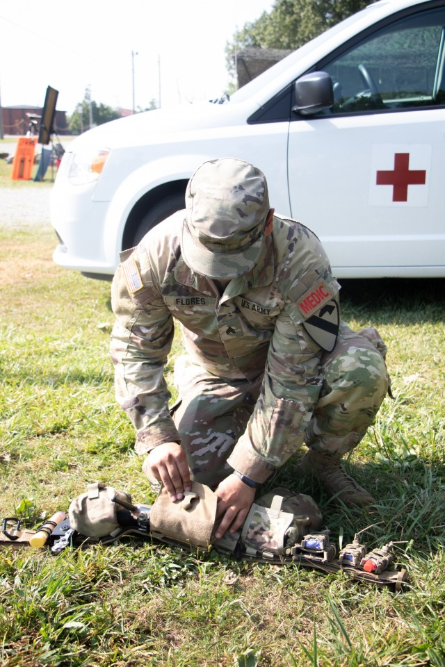 Sgt. Miguel Flores adjusts his gear at Warrior Skills at Advanced Camp at Fort Knox, Ky on July 7, 2021. | Photo by Marissa Wells, CST Public Affairs Office.