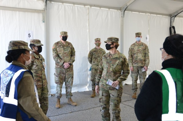 Brig. Gen. Paula Lodi, center, then-commander of Regional Health Command-Atlantic, visits with Soldiers at the Eisenhower Army Medical Center at Fort Gordon, Ga., in January 2021. Soldiers at Fort Gordon shifted some operations outdoors to follow COVID-19 safety protocols during pandemic restrictions.