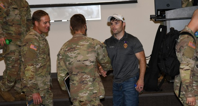Decorated U.S. Army veteran and motivational speaker J.P. Lane talks with Soldiers after a session focused on resiliency at Fort Rucker July 20, 2021. (U.S. Army photo by Kelly Morris)