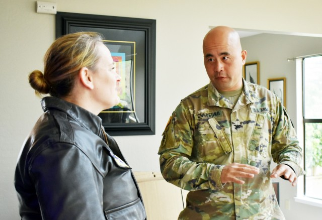 Col. Varman Chhoeung, commander of U.S. Army Garrison Presidio of Monterey, speaks with Air Force Lt. Col. Jen Whetstone, who is moving to Japan with her family, as movers pack up her household goods in Pebble Beach, Calif., July 16. Chhoeung accompanied a quality assurance inspector with the Presidio of Monterey Transportation Office to speak with service members and their families and ensure their permanent-change-of-station moves are going well.