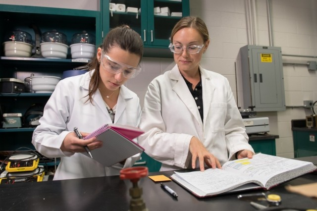 Isabella Costa, left, a Brazilian post-graduate researcher, works alongside Victoria Blair, a materials engineer with the U.S. Army Research Laboratory, on the hunt for materials science breakthroughs.