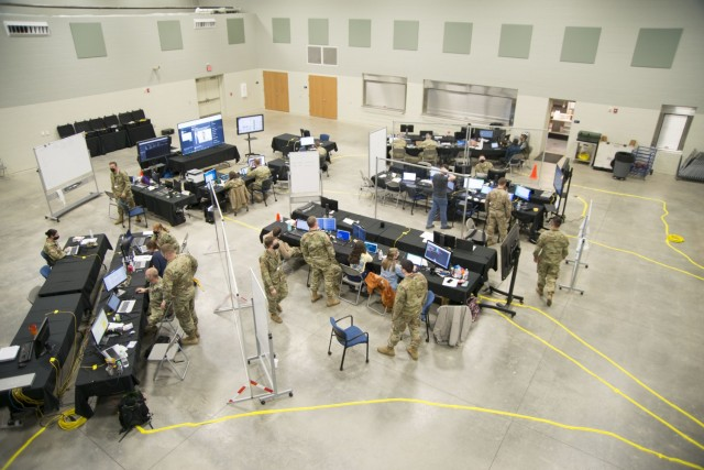An overview photo of the Exercise Locked Shields 21 operations center in Morgantown, W. Va., is captured as exercise participants work to secure networks and compete against 21 other Blue Teams across the globe. Locked Shields 21 is the world's largest cyber defense exercise, with individuals from nearly 30 nations participating this year. (Photo by U.S. Army Chief Warrant Officer 2 Jeremiah Bennett)