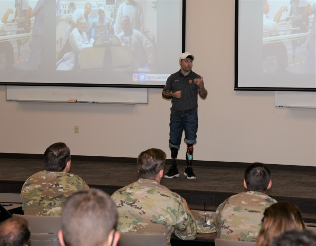 Decorated U.S. Army veteran and motivational speaker J.P. Lane shares his personal story with students from the Aviation Captains Career Course, Basic Officer Leaders Course, and Warrant Officer Basic Course during a special session at Fort Rucker July 20, 2021. The session included a focus on persistence, spiritual resiliency and the power of a cohesive Army team. (U.S. Army photo by Kelly Morris)