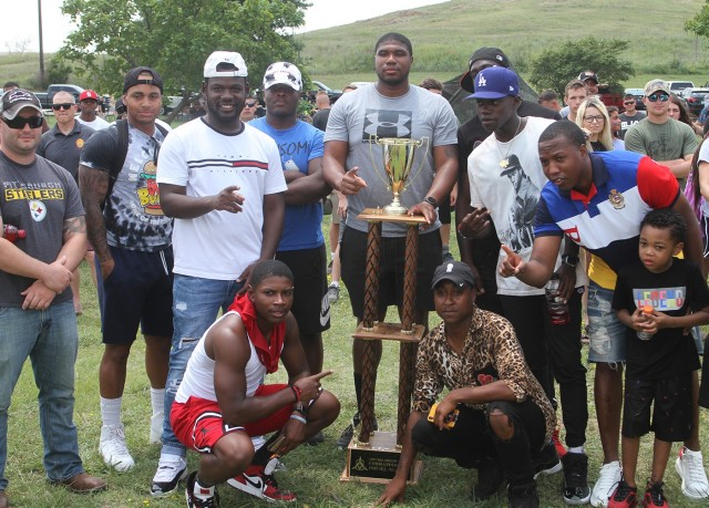 1st Battalion, 14th Field Artillery Soldiers pose with their trophy for winning the commander's cup July 22, 2021, at Fort Sill, Oklahoma. The 75th Field Artillery Brigade celebrated its 100th anniversary with sports competitions and observances of the brigade's heritage.