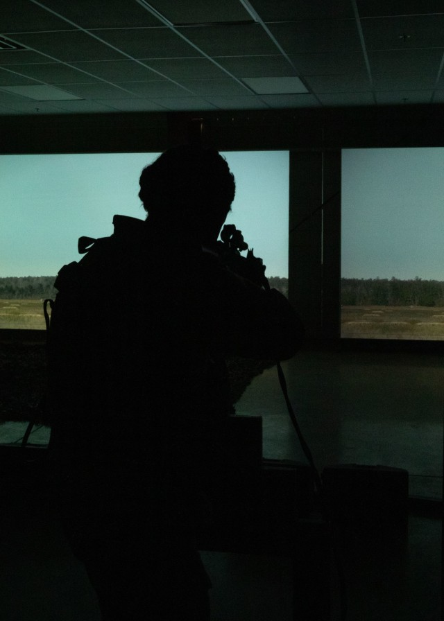 A Cadet participates in Engagement Skills Training (EST). During this virtual training, Cadets shoot a variety of targets at several distances, simulating what it's like to fire live ammunition on a range. Fort Knox, Ky. July 16, 2021   Photo by Olivia Van Den Heuvel, CST Public Affairs