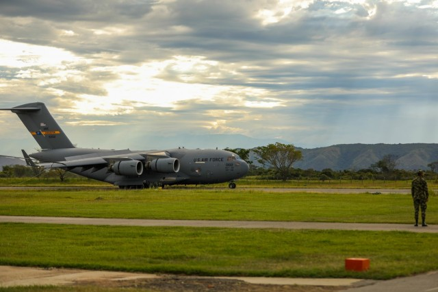 A U.S. Air Force C17 Globemaster III lands at Tolemaida Air Base, Nido, Colombia, July 21, 2021. The C17 carried U.S. Army paratroopers assigned to 2nd battalion, 501st Parachute Infantry Regiment, 1st Brigade Combat Team, 82nd Airborne Division for a Dynamic Force Employment with the Colombian military. (U.S. Army photo by Pfc. Joshua Taeckens)(This photo was edited from the original version)