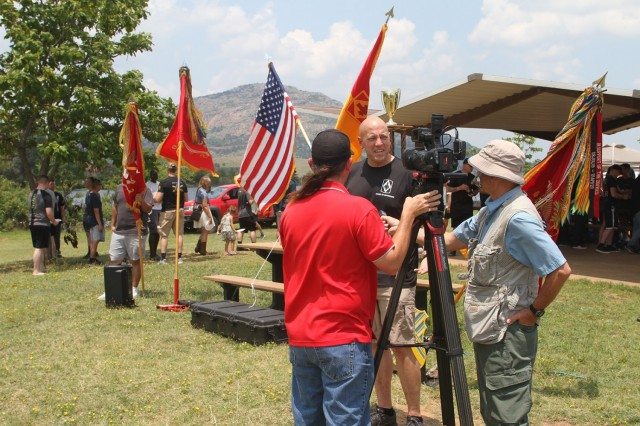 Col. David Norris, 75th Field Artillery Brigade commander, addresses local media representatives at the Diamond Week organization day at Lake Elmer Thomas Recreation Area on Fort Sill, Oklahoma. Brigade members celebrated the 100th anniversary of the unit.